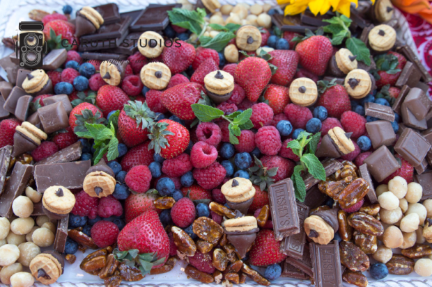 acorn cookie treats amongst berries and chocolates