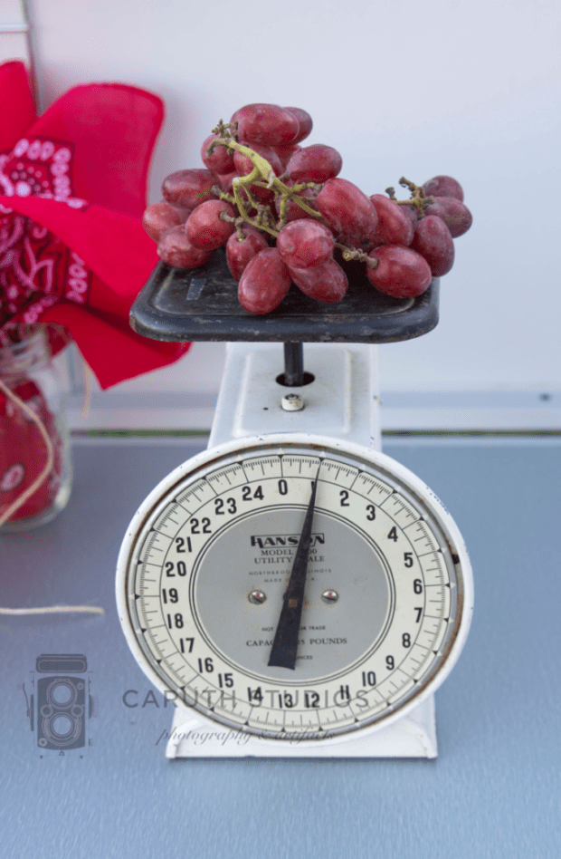 vintage scale with grapes on it