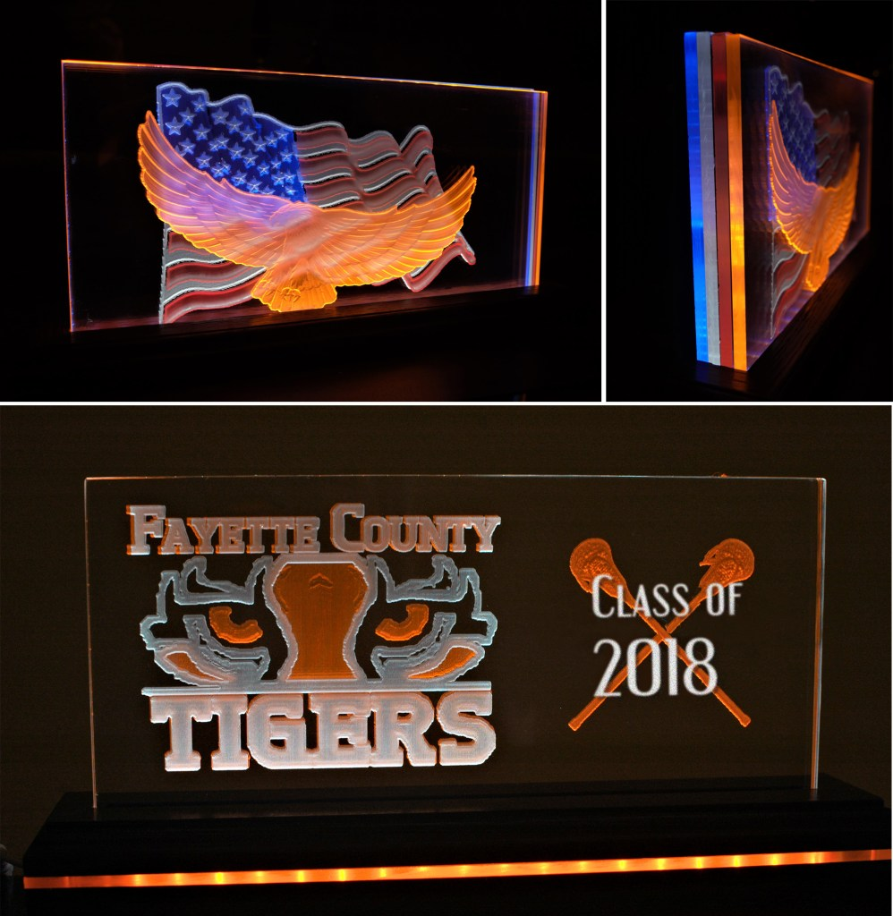 carved side lit acrylic signs with colored layers
