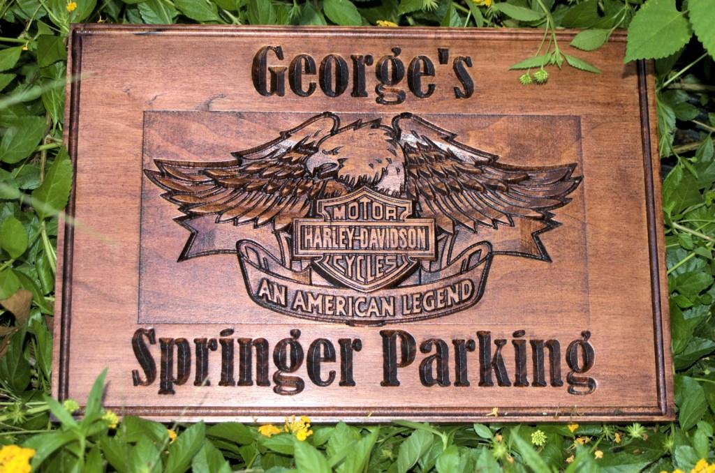 George's Springer Parking with carved Harley-Davidson logo.