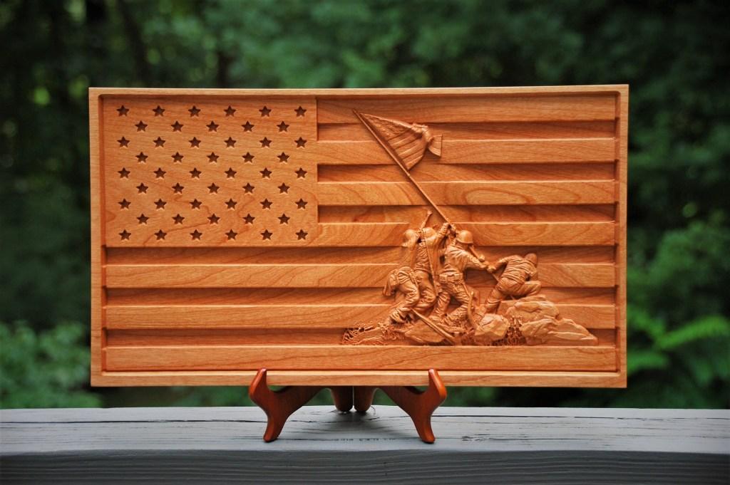 US flay with Iwo Jima flag raising carving