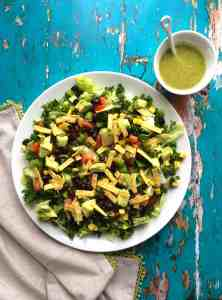 Vegan mexican salad with chopped kale and santa fe dressing