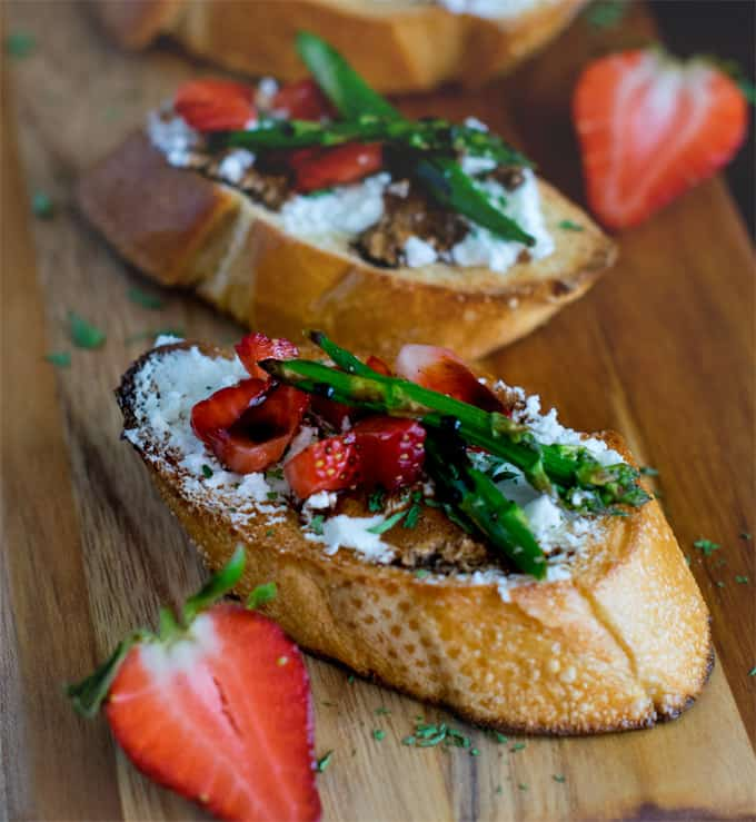 Asparagus strawberries goat cheese crostini with balsamic glaze