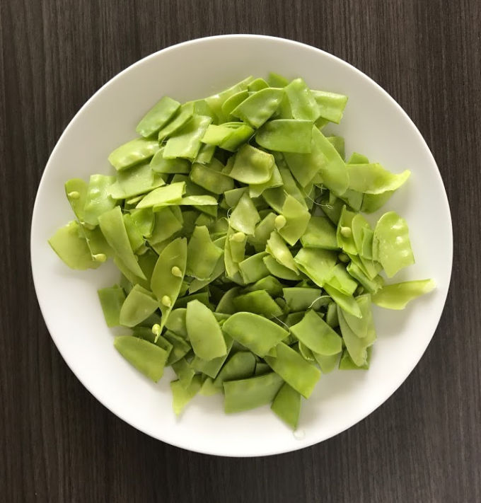 Snow peas on a white plate