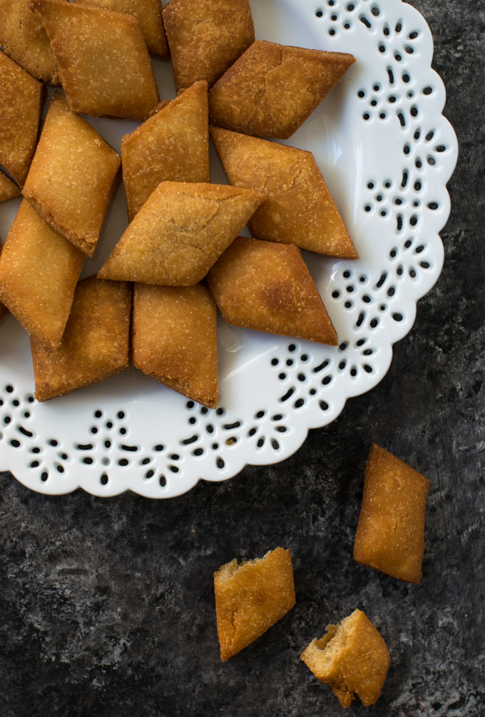 Fried Shankarpali on a white plate