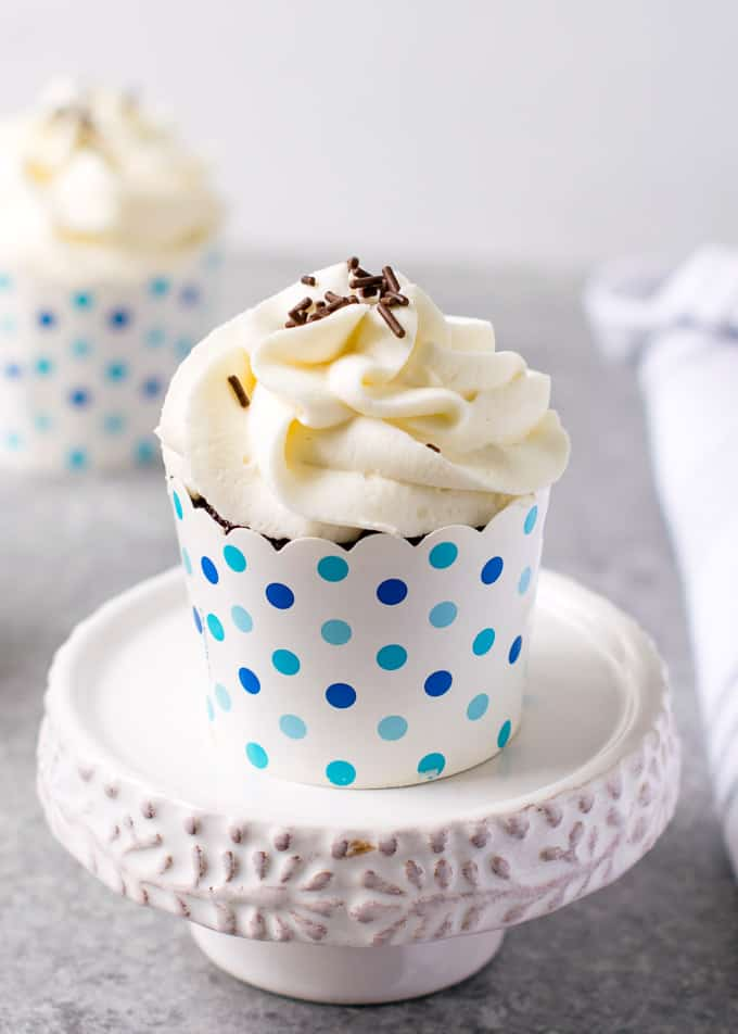 Chocolate cupcake with Mascarpone Frosting on a cake stand
