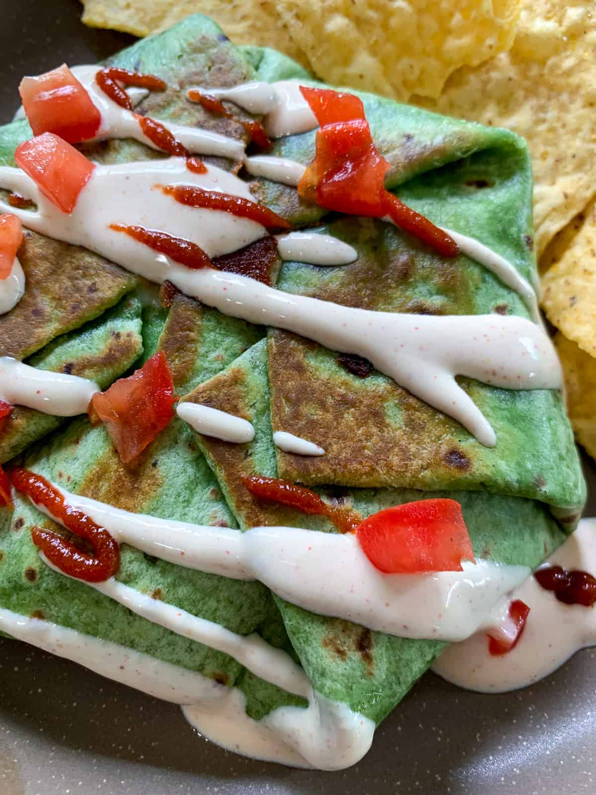 Wrap on a plate with chips and sauce.