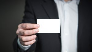 man in suit with business card