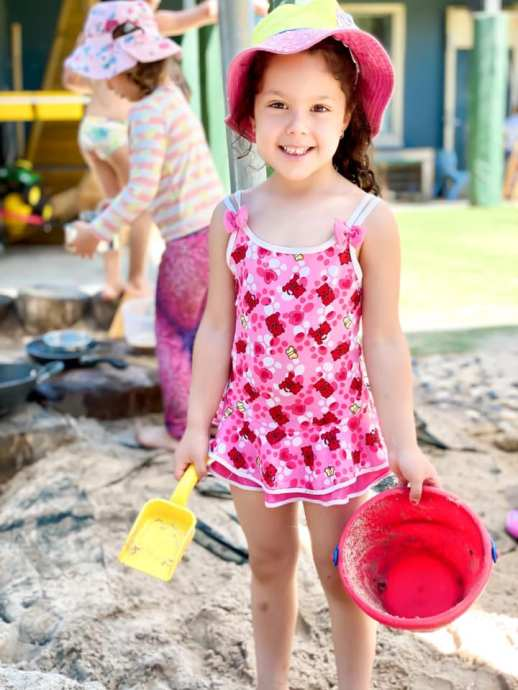 girl with bucket and spade