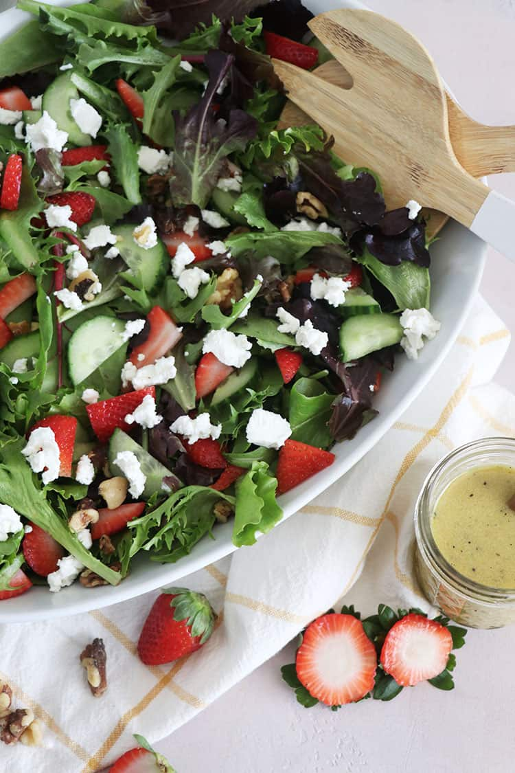Aspringseasonalsaladfeaturing mixed greens, slicedstrawberries, andgoat cheese, tossed together in a Dijon Vinaigrette - this salad is perfect as a side, or complete meal with your favorite protein!