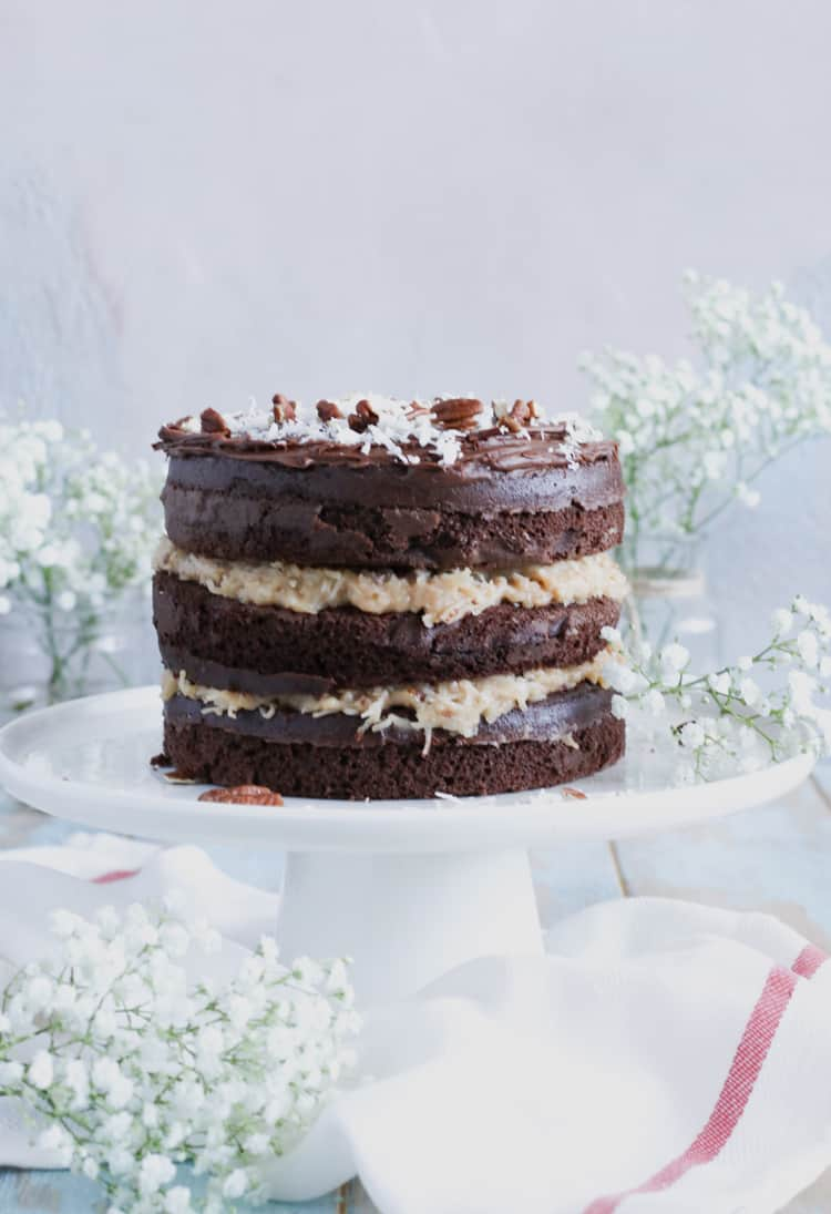 Boxed Chocolate Cake Mix, layered with homemade sweet coconut and pecan filling, give this classic cake a more modern look!