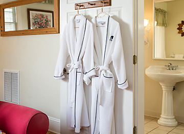 logo monogrammed robes for guest use during their stay