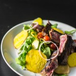 Steak and tomato salad with golden beets