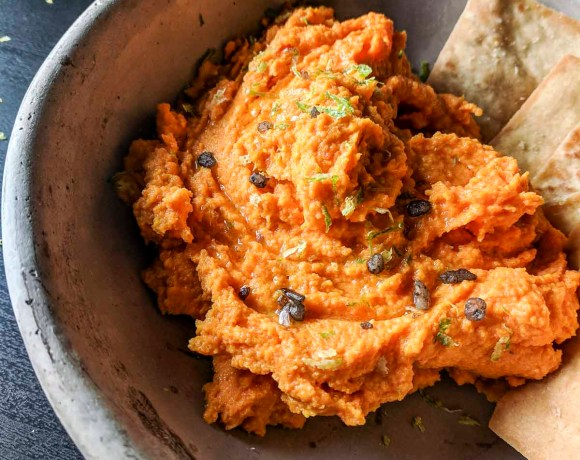 Close up of Paleo Carrot Hummus in a bowl