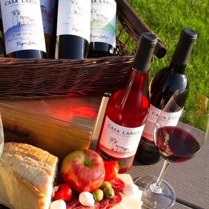 Varying Casa Larga Wines in wicker basket, Fruit and Cheese at Casa Larga Vineyards