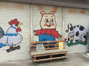 These happy farm animals were painted outside a local butcher shop