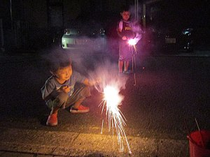 The two friends light up another round of sparklers