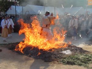 Monks run through the flames during Miyajima's Firewalking Ceremony