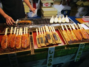 Grilled rice cakes (yaki onigiri) on a stick