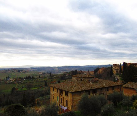 A view of Tuscany's rolling hills over the picturesque homes of San Gimignano.