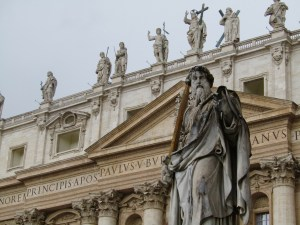 A statue of St. Paul at St. Peter's Basilica. Jesus is front and center atop the facade flanked by St. John the Baptist and St. James the Greater to the right and St. Andrew and St. John the Apostle to the left.