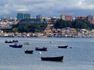 Fishing boats in the Douro River near the mouth of the Atlantic Ocean.