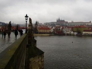 Crossing the Vltava River via the Charles Bridge.