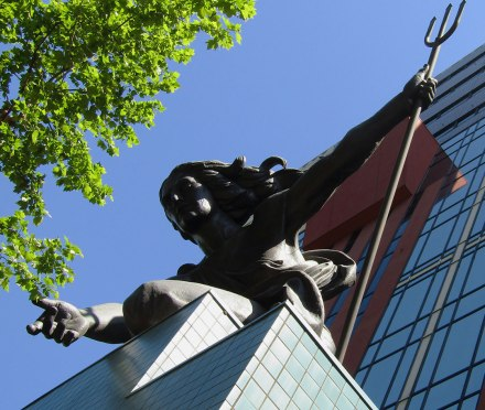 The Portlandia statue looks down over 5th Ave. in Downtown Portland from her perch atop the Portland Building.