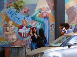 """Some """"cool kids"""" in the streets of Cairo. Most women do not show their shoulders or arms."""