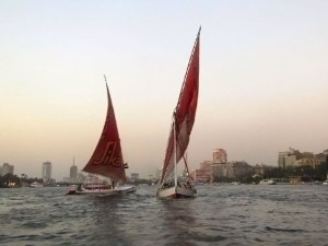 Sails dancing in the water as the sun sets.