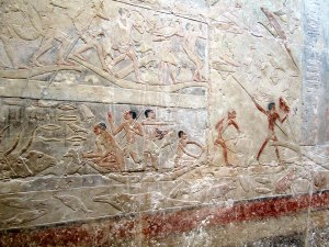 Pyramid Texts in the tomb of Idut describe a fishing scene on the Nile. Can you spot the hippopotamus, crocodile, fish and the cow being separated from her calf?