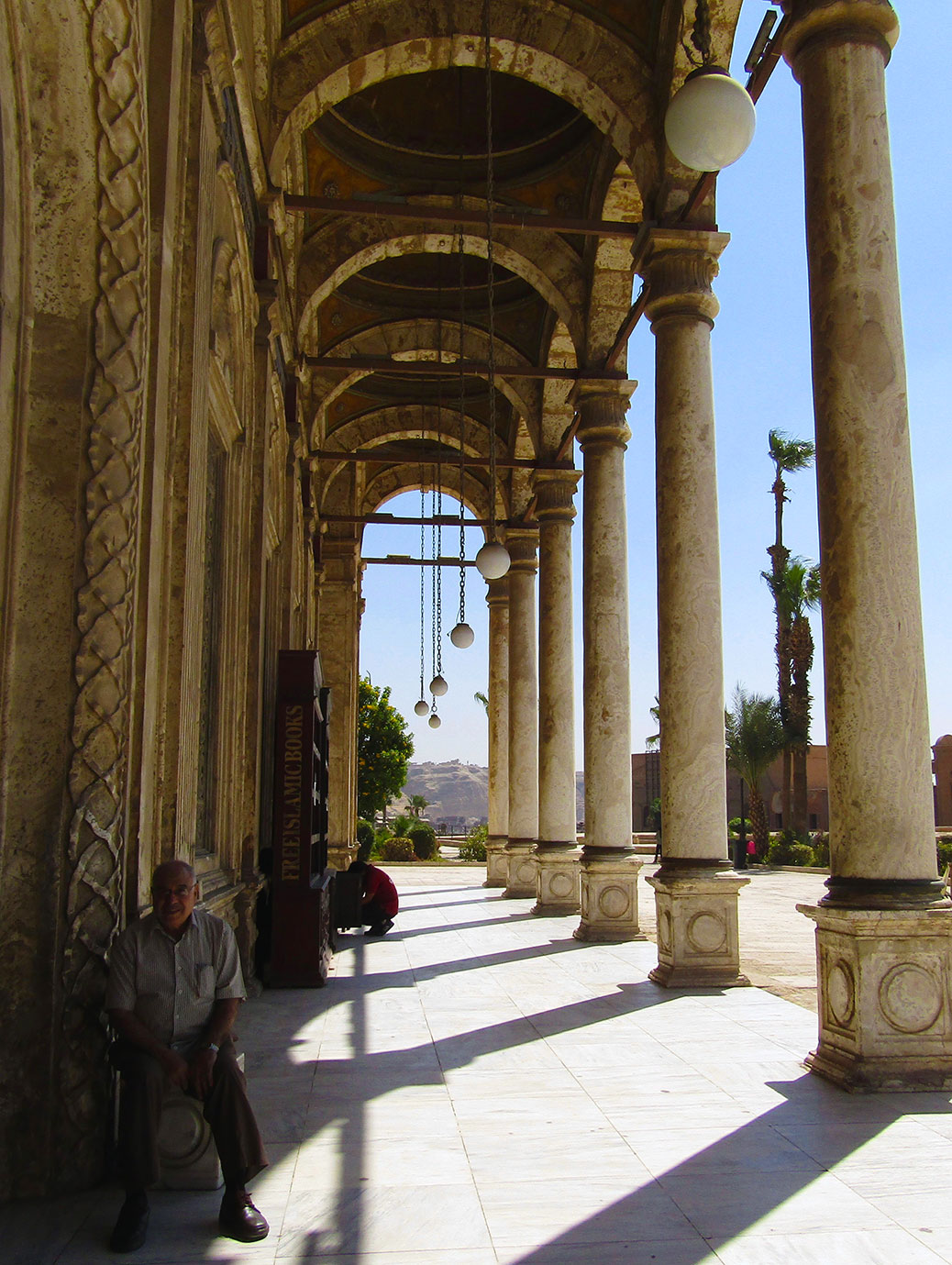 Corridor of arches along the exterior of the mosque.