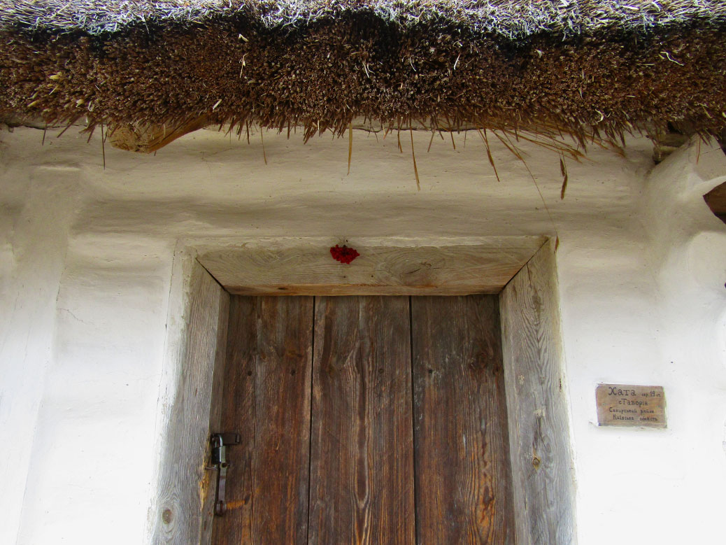 This 19th century home has kalyna hung over the doorway. Kalyna is a red berry similar to cranberries and is a national symbol of Ukraine.