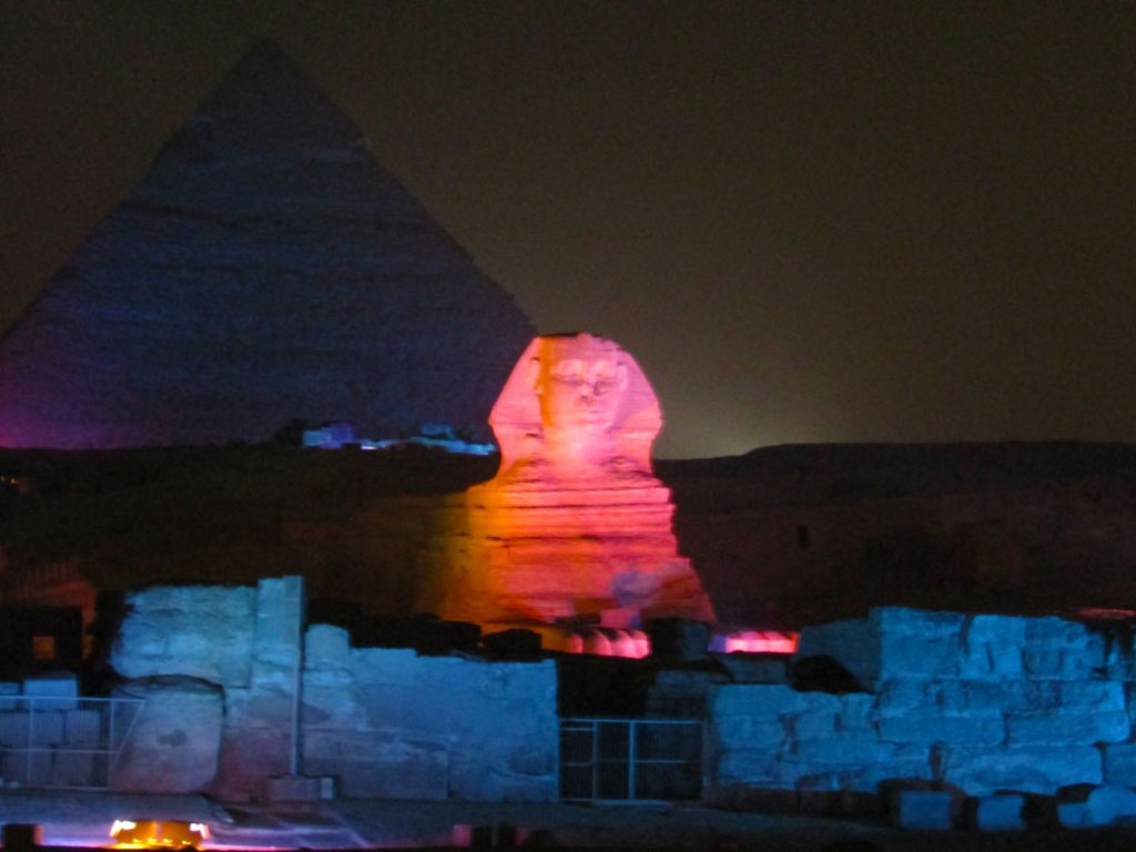 The Great Sphinx. Can you spot his lion paws? The Sphinx is thought to represent the Pharaoh Khafre, whose pyramid is behind the Sphinx from this view.