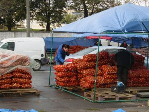 Bags and bags and bags of onions. My aunt says that people stock up and keep them in their cellars. This guy's wife is probably telling him over the phone how many onions she wants.