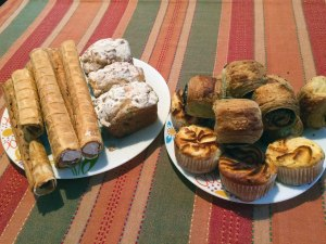 Rolled wafers with caramel and cream, coffee cakes, poppy seed rolls and cheese muffins.