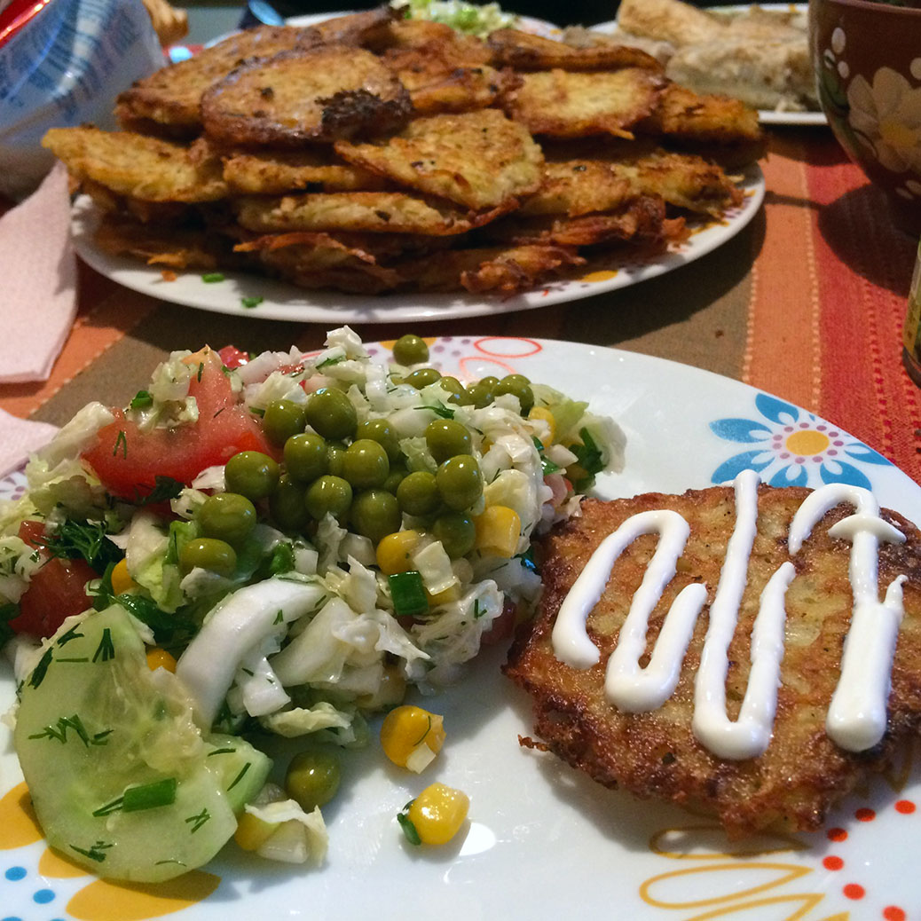 Salad and potato pancakes topped with sour cream, of course!