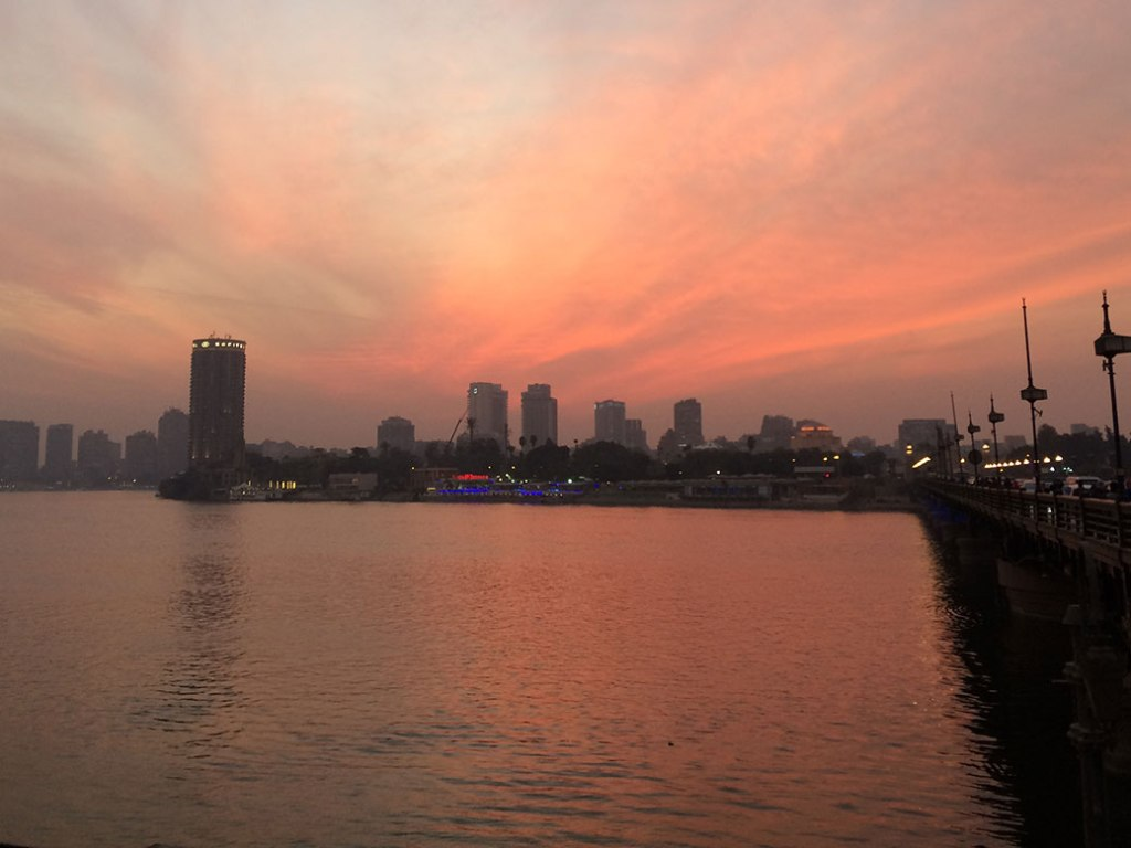 Sunset over the Nile River from the east end of the Qasr El Nil Bridge.