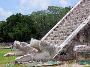 Snake (Kukulkan) heads at the bottom of El Castillo pyramid in Chichen Itza.