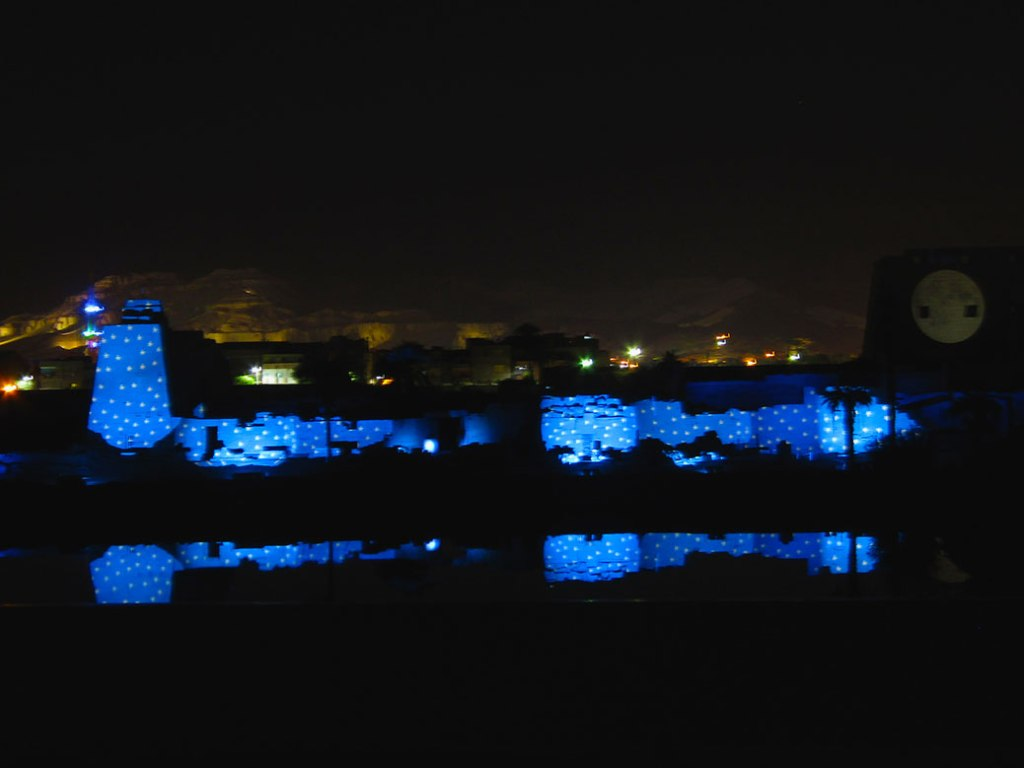 The Sound and Light Show at Karnak Temple reflects on the Sacred Lake.