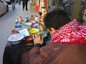 A sand artist shows off his skills on an Amman side street.