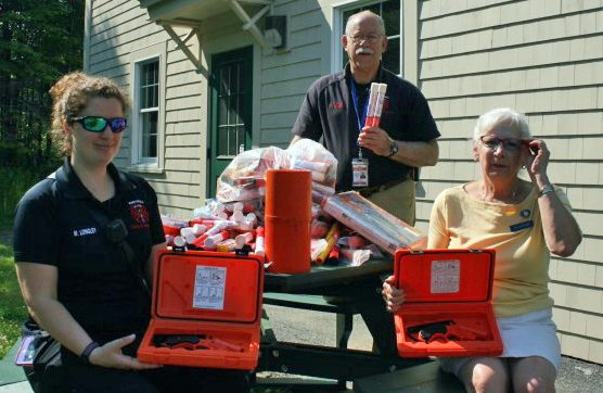 Harpswell Fire officials and Rep. Jay McCreight pose with expired marine flares.