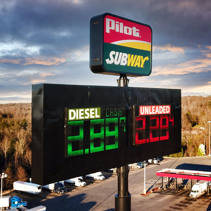 High rise Pilot gas station price sign with Subway