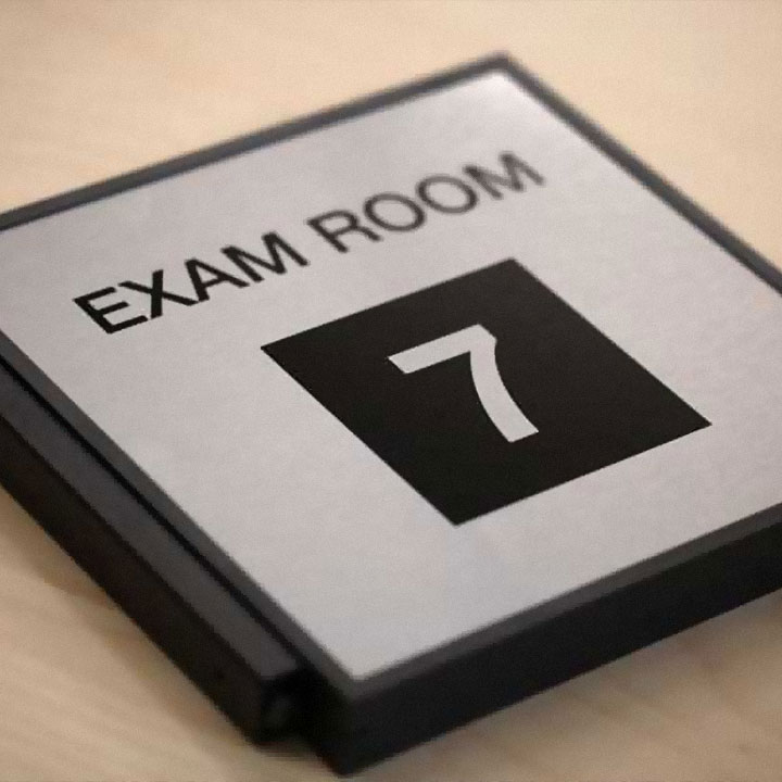 Wayfinding sign indicating exam room 7