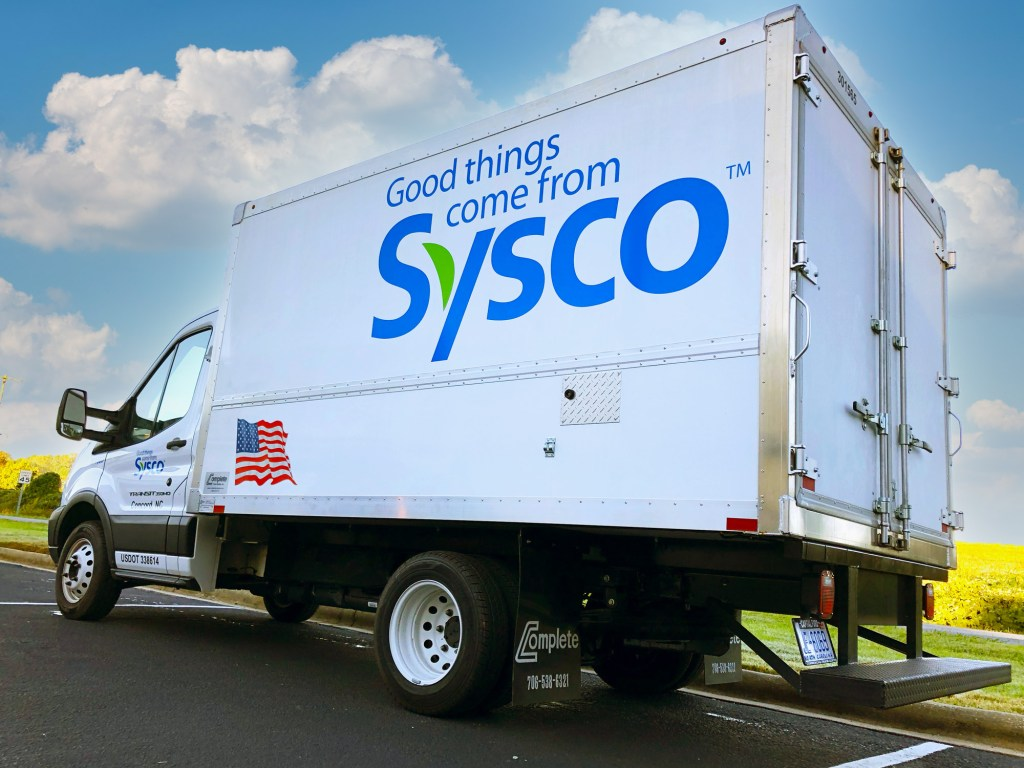 Box truck with vinyl lettering.