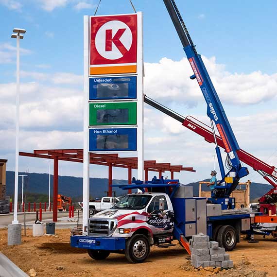 Casco installers putting up a gas station price sign