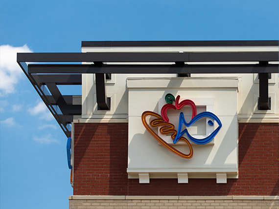 Architectural features juxtaposed with the Harris Teeter logo