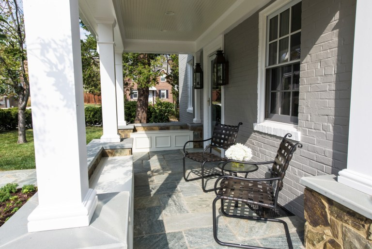 porch addition on virginia home flagstone floors painted brick house