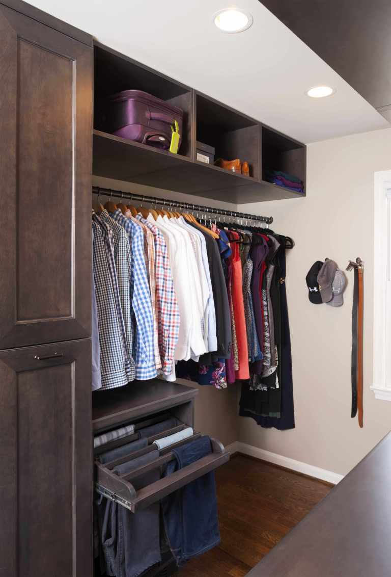 master bedroom walk in closet lots of storage and shelving