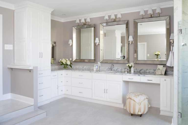neutral palette renovated bathroom traditional style white cabinetry plenty of storage